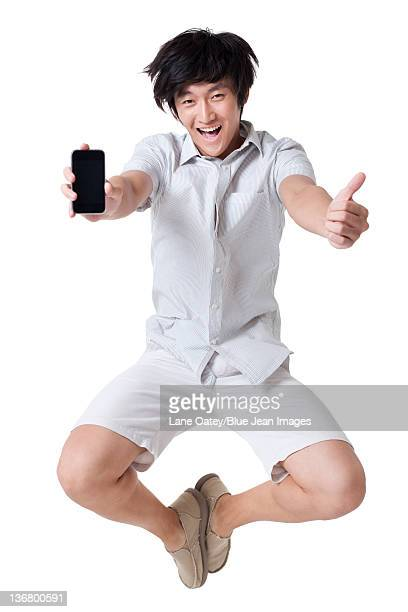 Young Man Jumping With a Mobile Phone