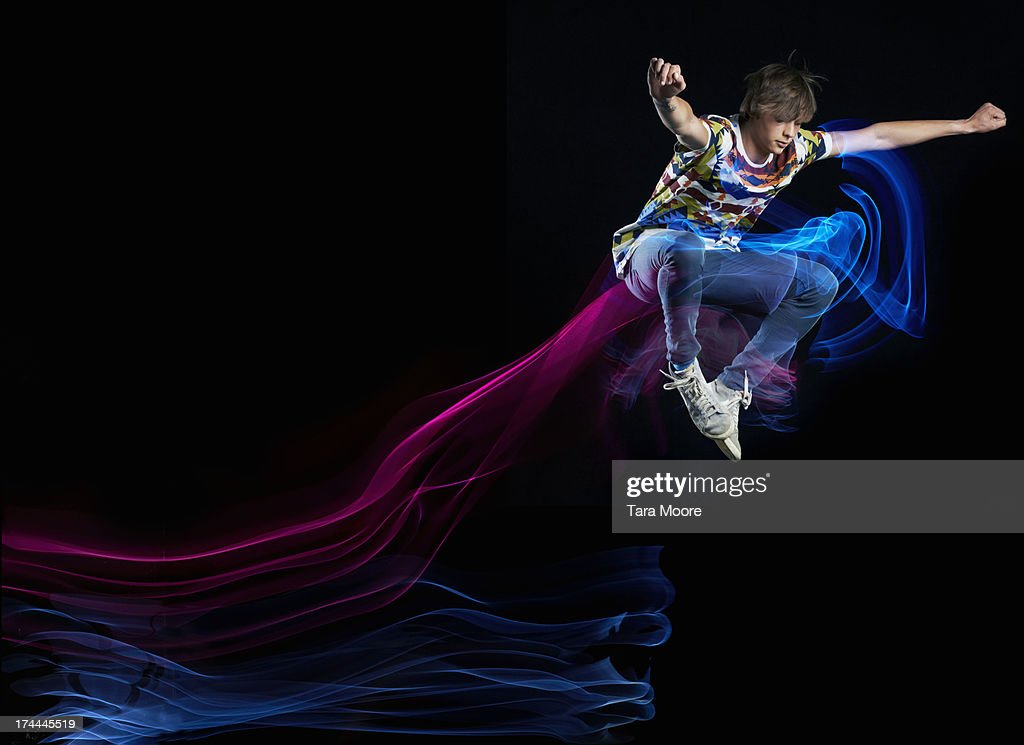 young man jumping with light trails : Stock Photo