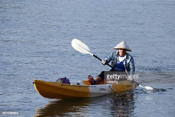 Young man kayaking on the Nam Song river Vang Vieng Laos