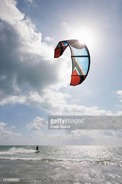 Young man kitesurfing