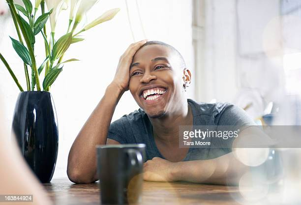 young man laughing and talking to friend