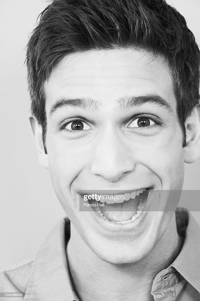 Young man laughing, portrait, close-up : Stock Photo