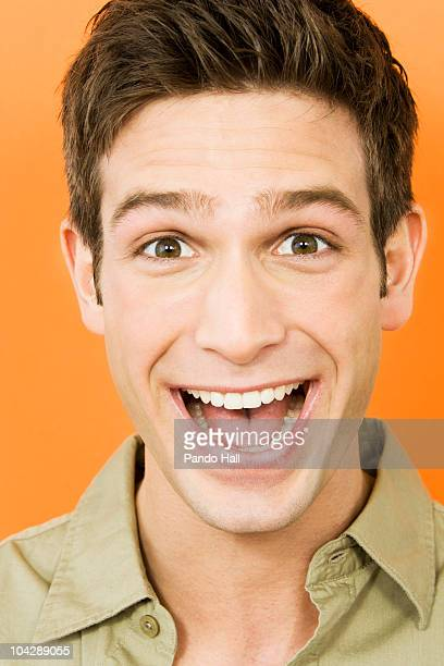 Young man laughing, portrait, close-up