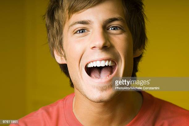 Young man laughing, portrait