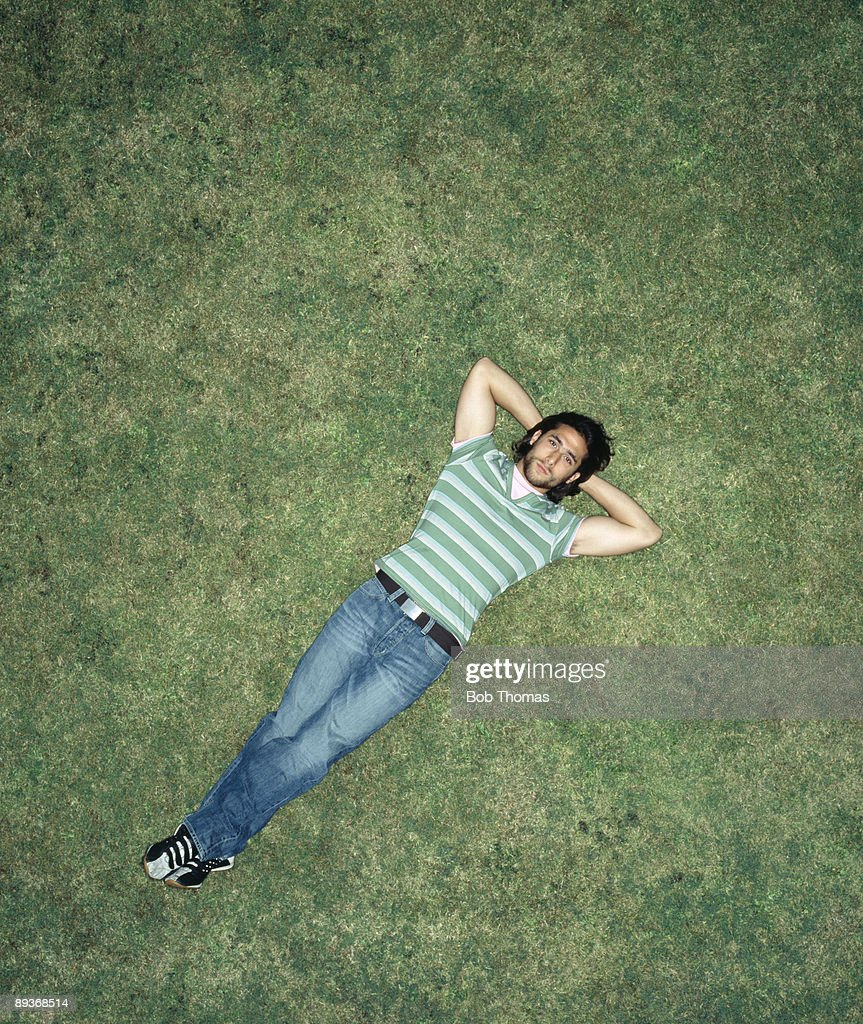 Young Man Laying On Grass : Stock Photo