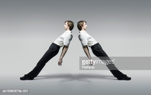 Young man leaning, side view (multiple exposure)
