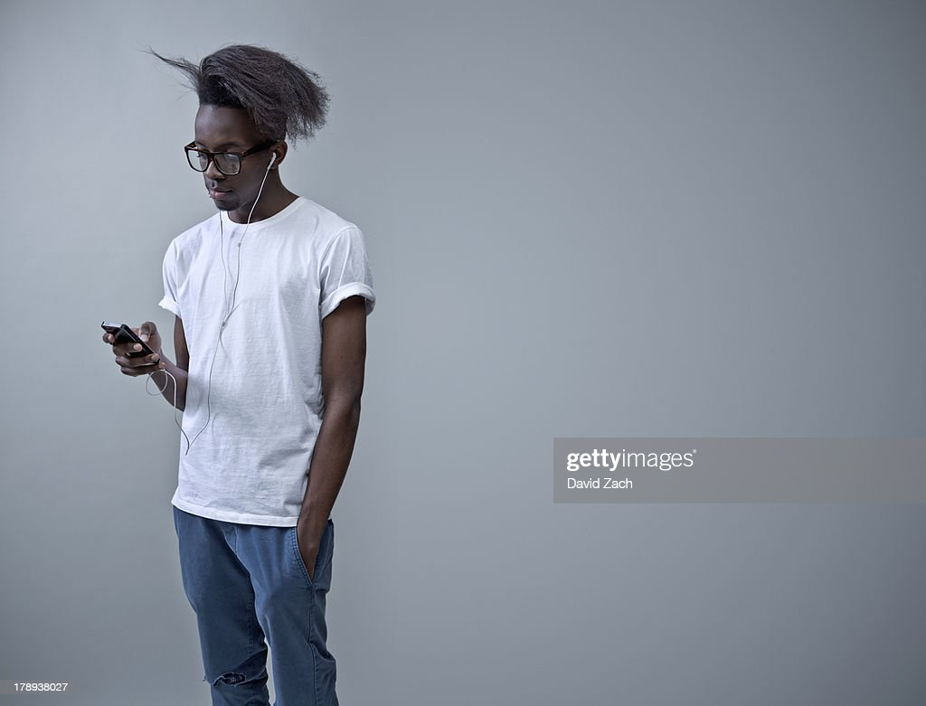 Young man listening to mobile phone : Stock Photo