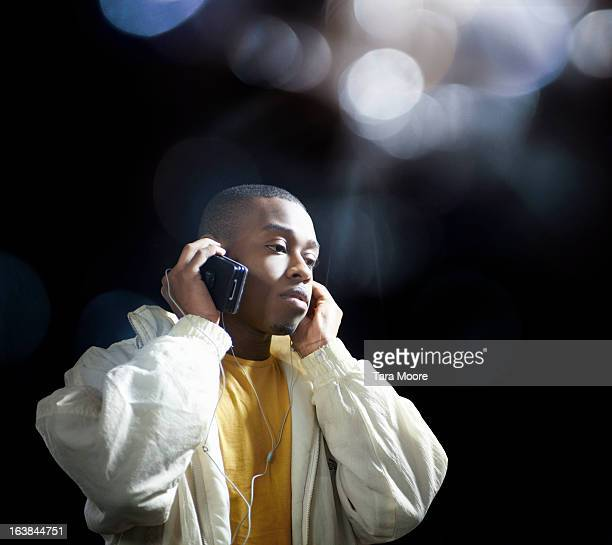 young man listening to music from mobile phone