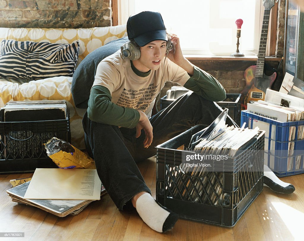 Young Man Listening to Music in a Cool Flat : Stock Photo