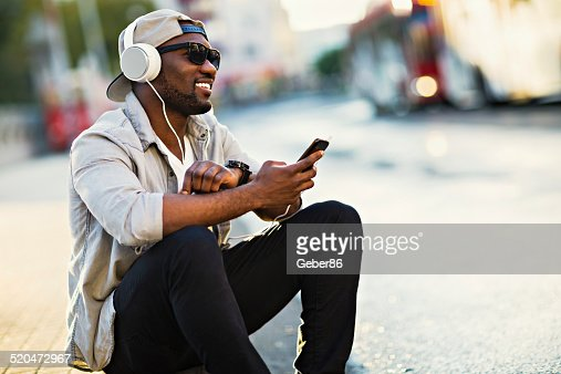 Young man listening to music on mobile phone