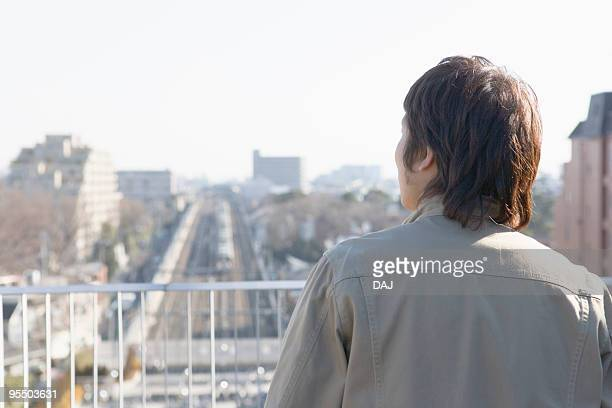 A Young Man Looking at the Town