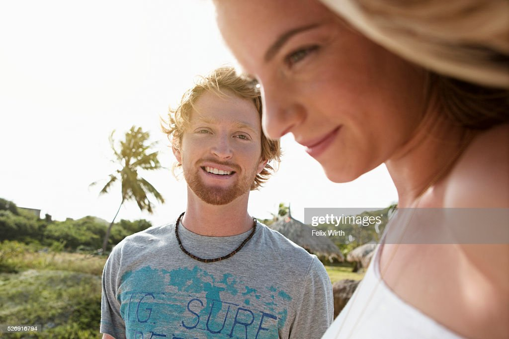 Young man looking at woman : Stock Photo