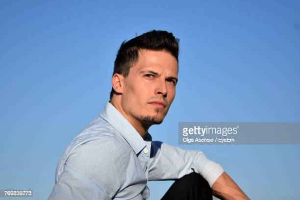 Young Man Looking Away Against Blue Sky