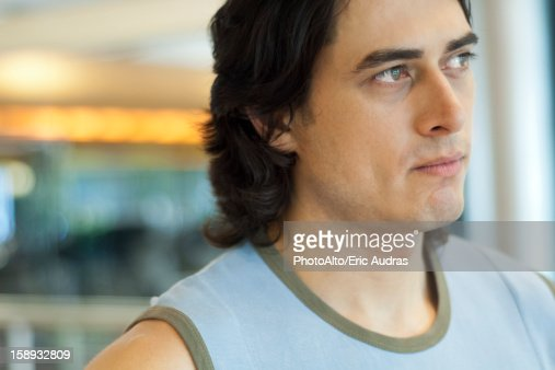 Young man looking away in thought