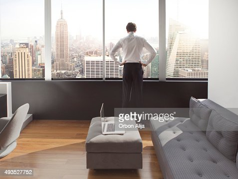 Young man looking out at city skyline