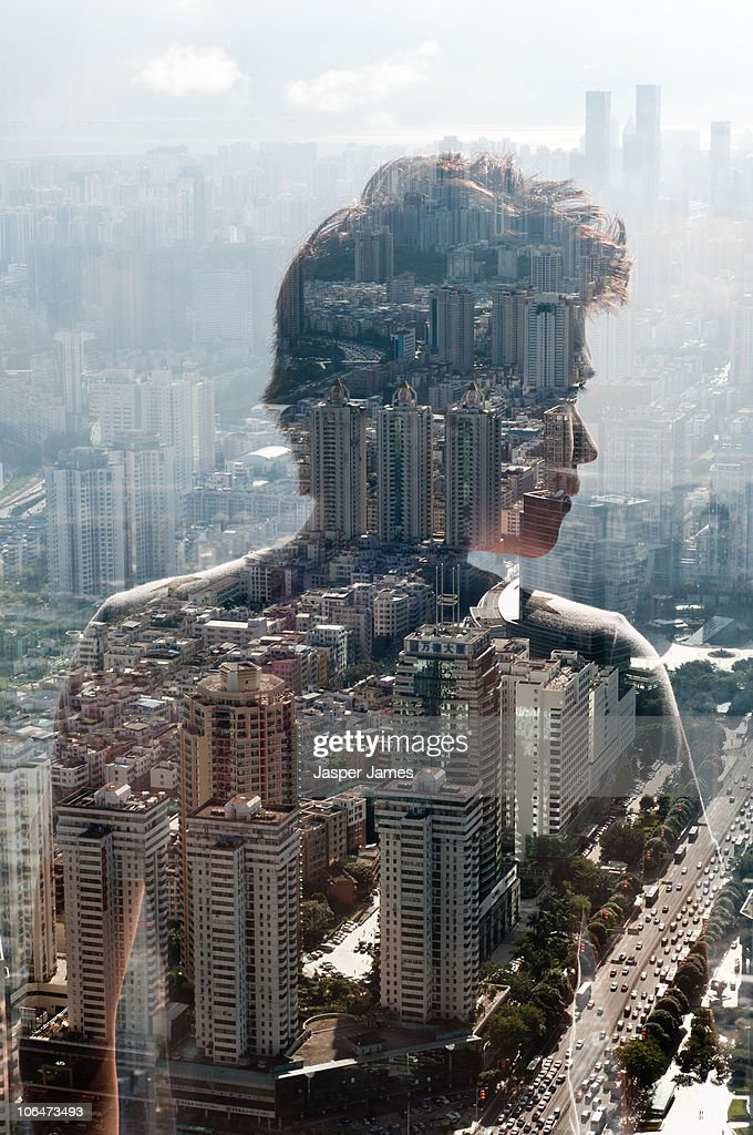 young man looking over city : Stock Photo