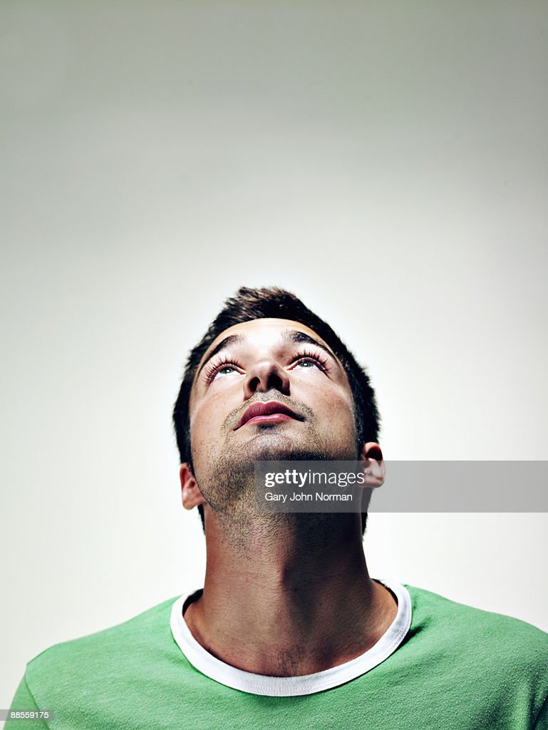 Young Man Looking Up Stock Photo | Getty Images