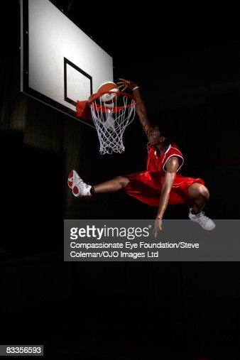 Young man making a fancy dunk