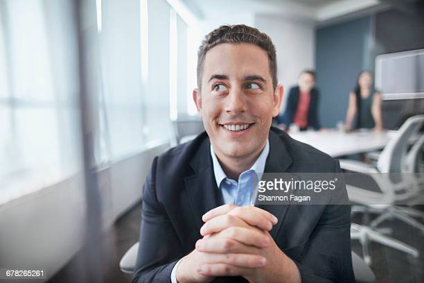 Young man making a silly face in office