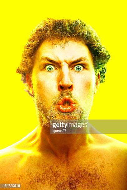 Young Man Making Crazy Face on Yellow Background