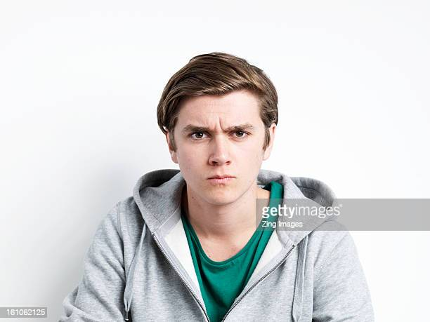 Young man making face