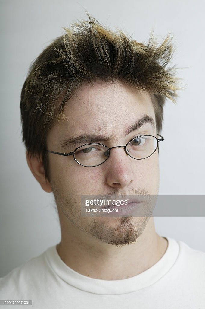 Young man making face, portrait : Stock Photo