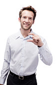 Young man making hand gesture, smiling, portrait