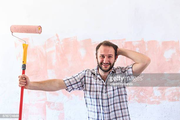 Young man making home redecoration alone