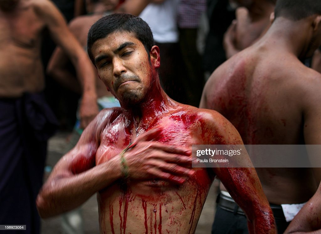 A young man marks the Day of Ashura, in a ritual where Shia muslims strike themselves till they are bloody with razors and chains on November 25, 2012 in Yangon, Myanmar. The day of Ashura is a national holiday held on the 10th day of Muharram in the Islamic calendar, with men beating themselves as they mourn the martyrdom of Husayn ibn Ali, the grandson of the Islamic Prophet Muhammad. In Myanmar there are approximately 20,000 Shia muslims.