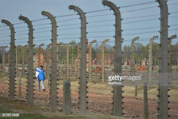 A young man meditates as he walks through the remains of the former camp during the annual March of the Living inside the former German Nazi Death...