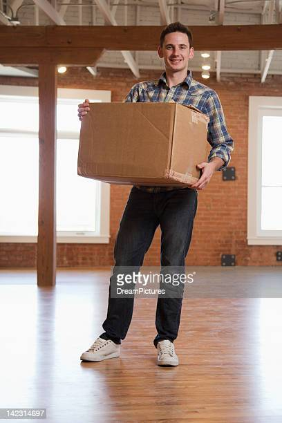 Young man moving into new loft apartment