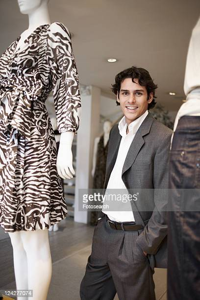 Young man near mannequins