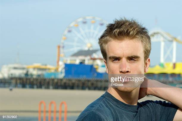 Young Man near Santa Monica Beach Pier Tourist Attraction