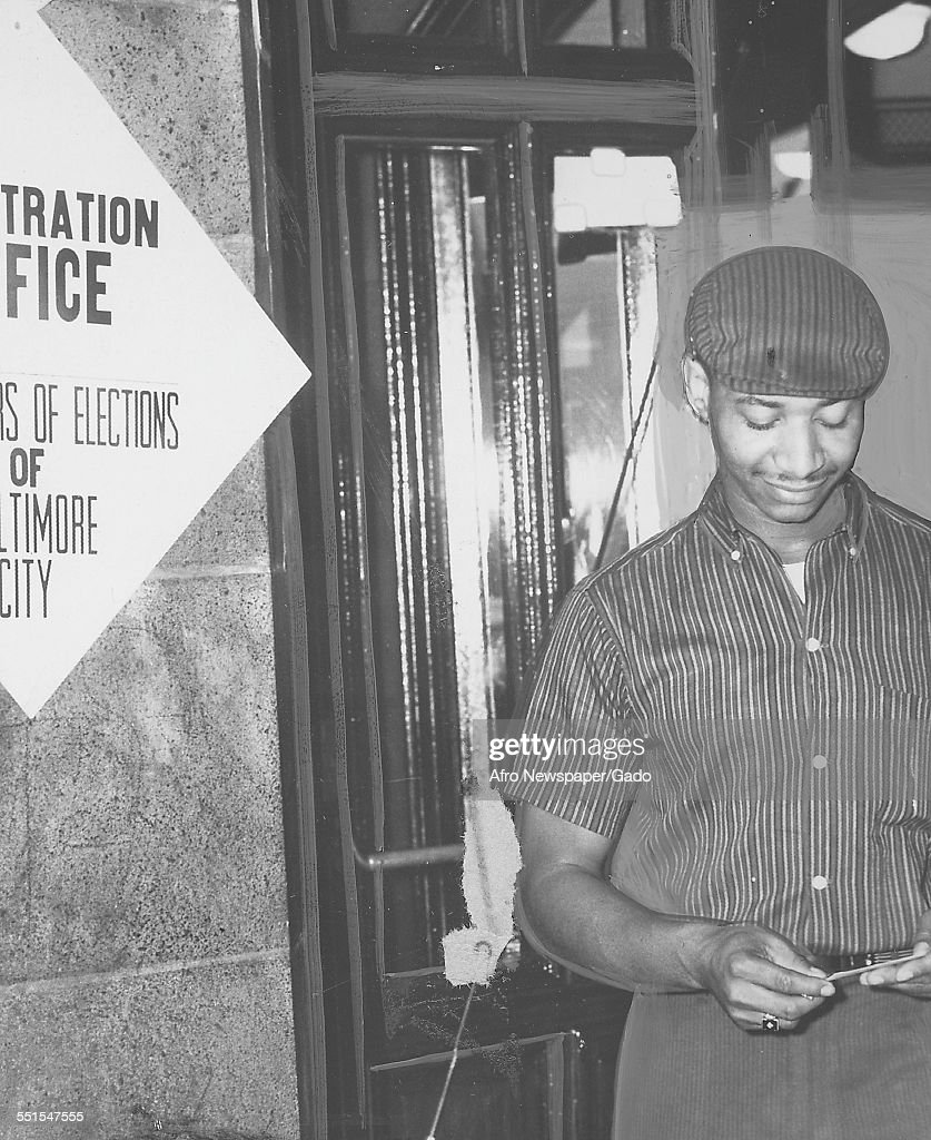 A young man of 21 looking at his voter registration card on the eve of the election September 20 1958