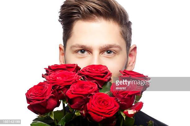 バラの若い男性を