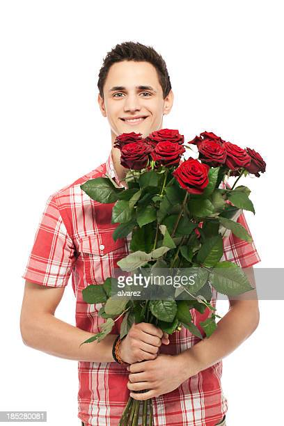 Young man offering roses