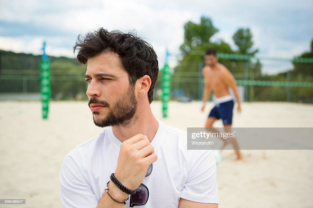 Young man on beach volleyball field