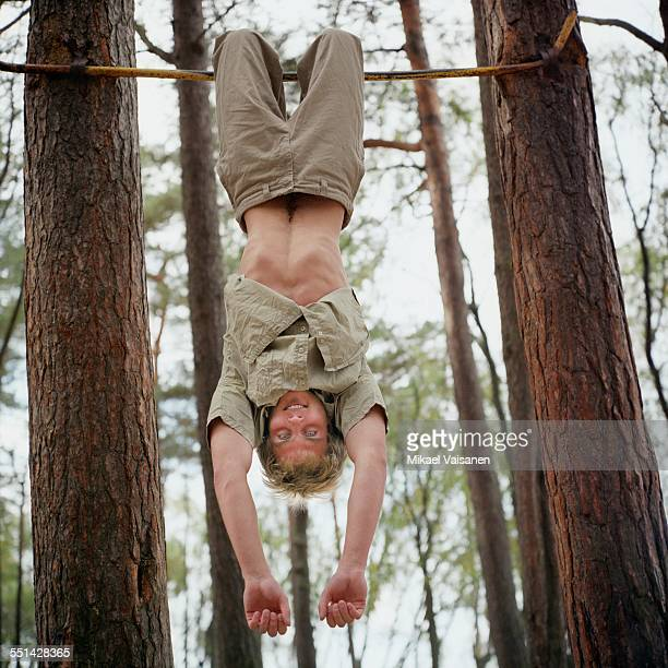 Young Man on Exercise Bar in Woods
