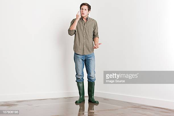 Young man on flooded floor