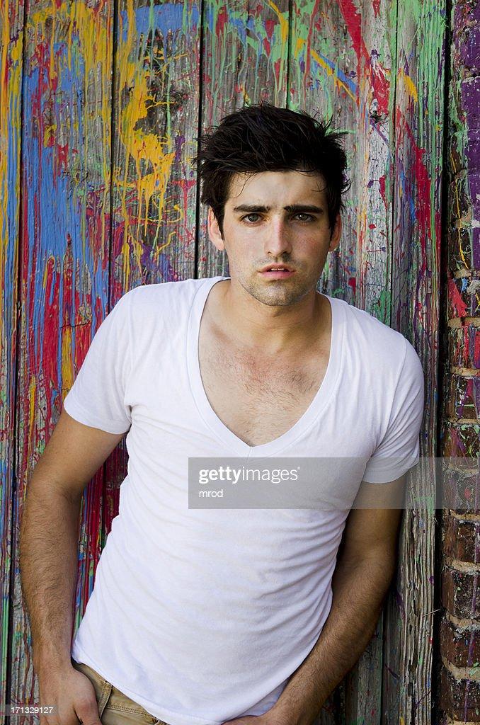 Young Man on Paint-Splattered Door