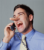 Young man on telephone, laughing, close-up