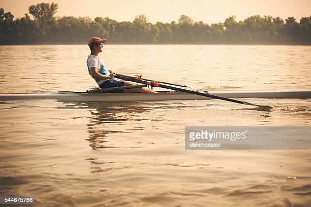 Young man on the river rowing