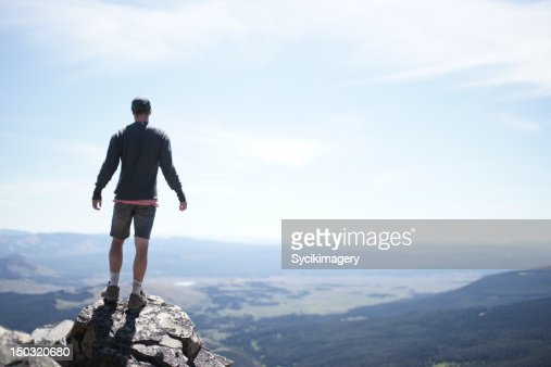 Young man on top of peak