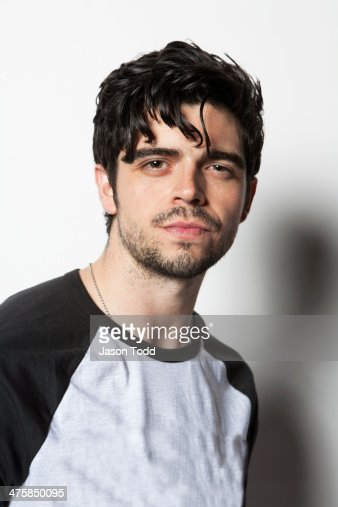 young man on white with shaggy black hair stock photo
