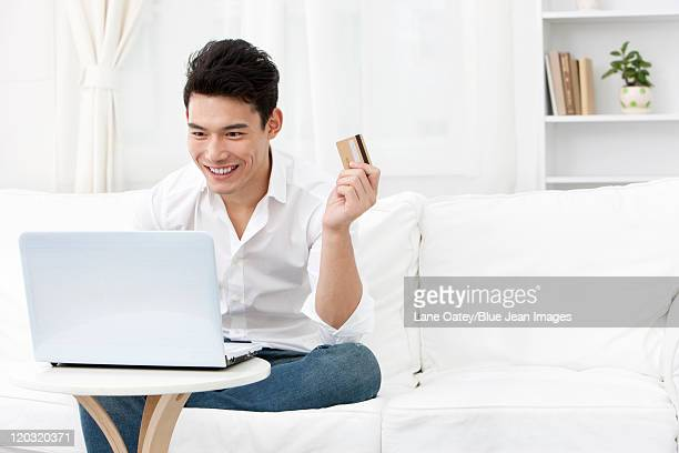 Young man online shopping