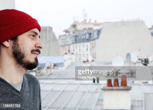 young man overlooking Paris. : ストックフォト