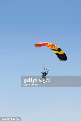 Young man parachuting, aerial view : Stock Photo