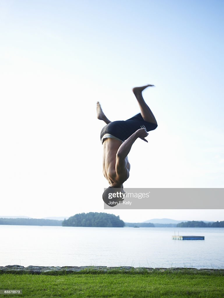 Young man performing flips : Stock Photo