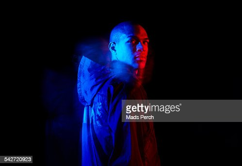 young man photographed with creative lighting