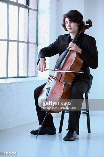 A Young Man Playing A Cello